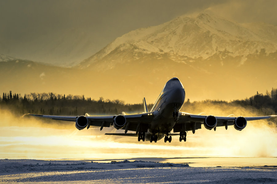 boeing-747-takeoff-anchorage-atlas-cargo-golden-sunlight-snow-blast-vanheijst.jpg