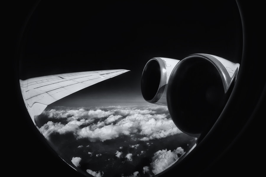 north-korea-air-koryo-ilyushin-il62-engines-wing-view-inflight-blackandwhite.jpg